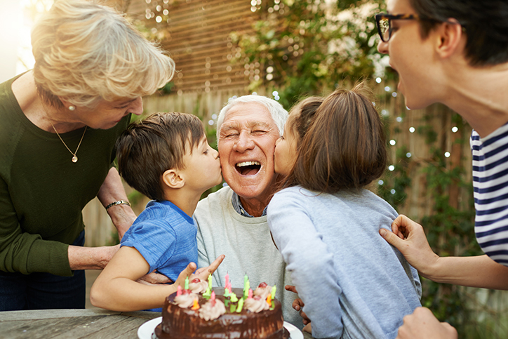 Man enjoying birthday with family